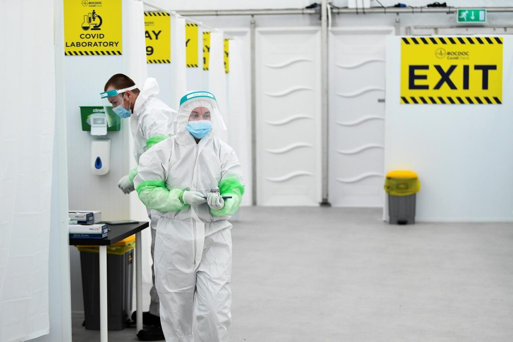 Lab technicians work at RocDoc's rapid antigen coronavirus disease (COVID-19) testing facility in conjunction with the Department of Transport, for hauliers bound for France via Dublin Port, at Dublin Airport, Ireland January 29, 2021. REUTERS/Clodagh Kilcoyne