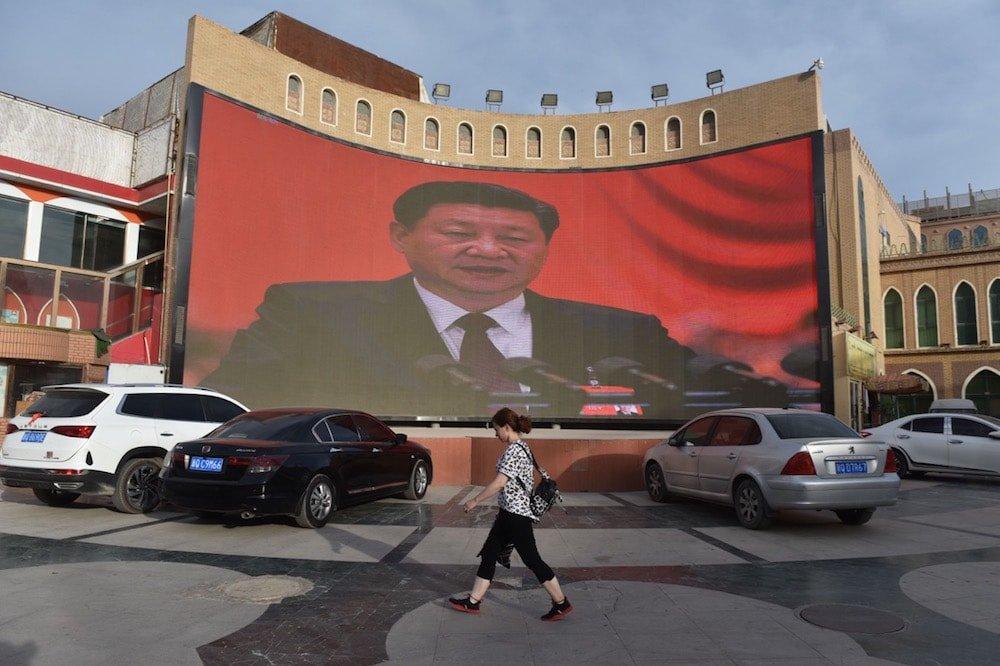 China Xinjiang Uyghur Surveillance Screen Jinping ©Getty Images