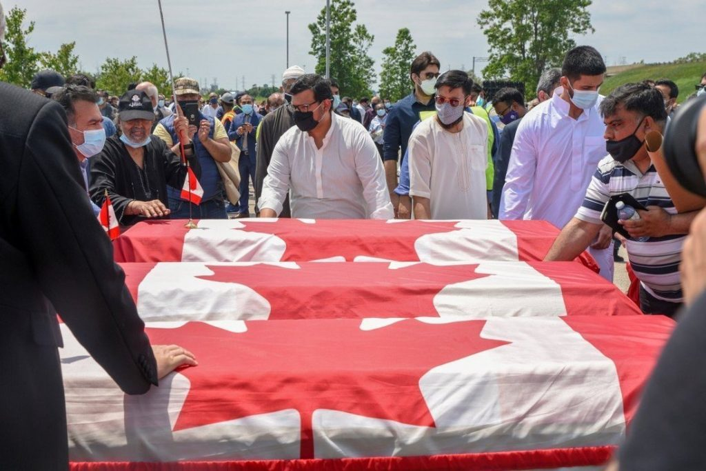 Mourners transport three flag-wrapped coffins at the funeral of the Afzaal family at the Islamic Centre of Southwest Ontario in London, Ontario, Canada on Saturday. Photo Reuters