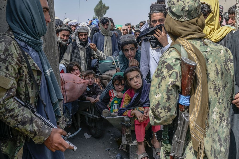 afghanistan retreat Taliban members stop people rushing to pass to Pakistan from the Afghanistan border on Sept. 25. Photographer Bulent Kilic AFP Getty Images